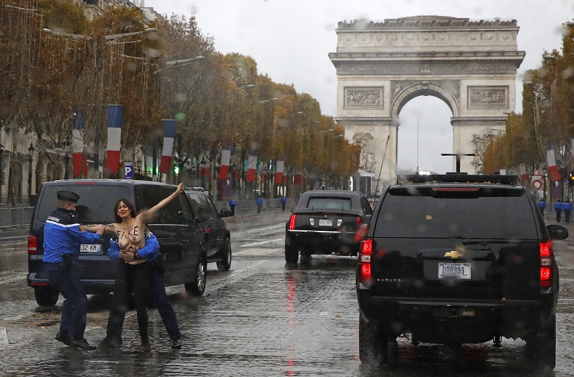 Topless Female Protesters Storm Trump's Motorcade